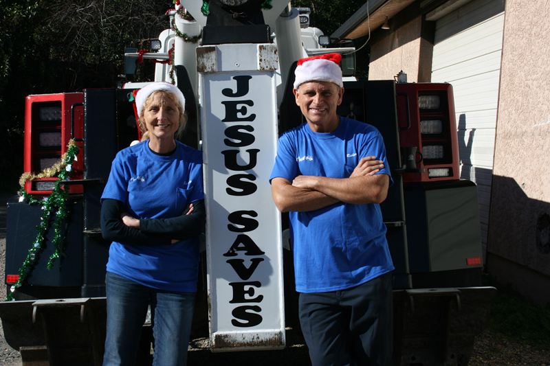 Sandy and Richard Owners of Classic Tow wearing Christmas hats
